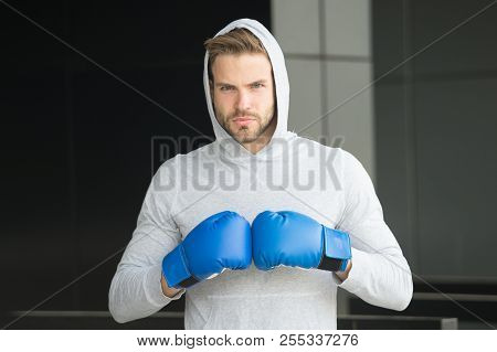 Focused Sport Goal Achievement. Sportsman Concentrated Training Boxing Gloves. Athlete Concentrated