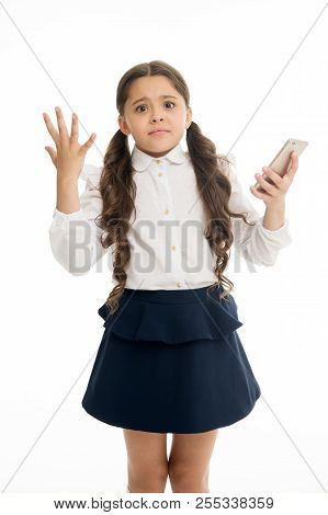 Girl cute long curly hair holds smartphone white background. Child desperate helpless face expression holds smartphone. Chatting friends online communication. Bad connection. Cell connection problem. poster