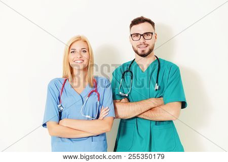 Doctors At Hospital Working With Partner. Healthcare And Medical Services.