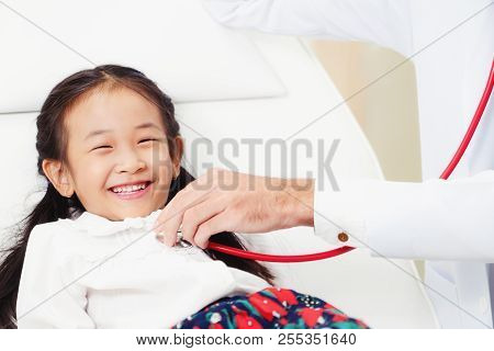 Doctor With Little Happy Kid At Hospital.