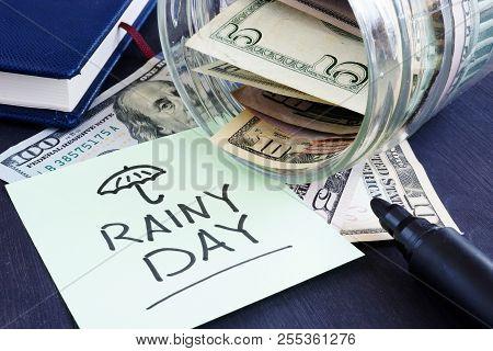 Rainy Day Fund Savings. Jar With Dollar Bills.
