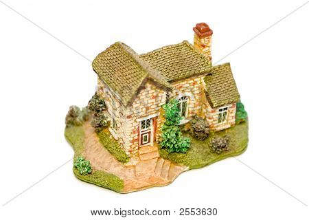Stone Model Of A Country Small House With A Garden