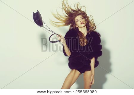 Young Pretty Woman Or Cute Sexy Girl With Long Beautiful Curly Blonde Hair And Adorable Face In Blac