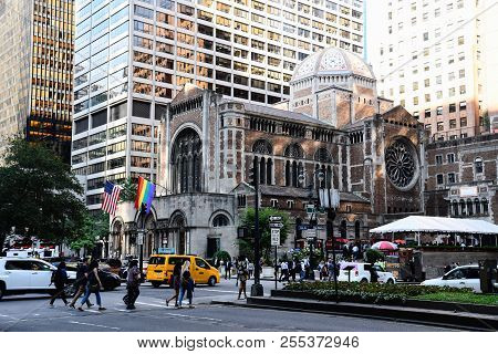 New York City, Usa - June 21, 2018: St Bartholomew Church In Park Avenue With American And Rainbow F