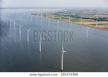 Aerial View Dutch Sea With Offshore Wind Turbines Along Coast