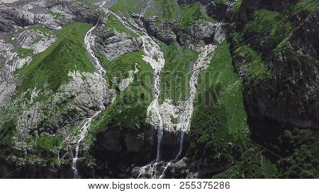 Mountain Waterfall Landscape. Waterfall Mountain View. Top View Of Green Rock Waterfall.