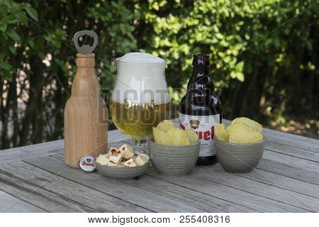 Sint Gillis Waas, Belgium - July 22, 2018: Duvel, Belgium Beer Feta Cheese And Salted Chips And A Wo