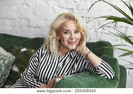 Picture Of Positive Attractive Middle Aged Female Wearing Natural Make Up And Elegant Clothes Relaxi