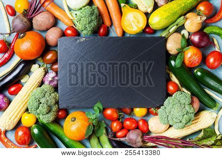 Autumn Farm Vegetables, Root Crops And Slate Cutting Board Top View With Copy Space For Menu Or Reci