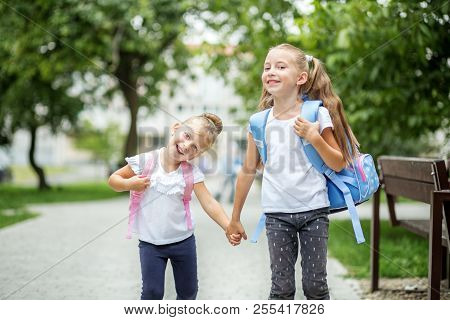Two Happy Children Go To School. The Concept Of School, Study, Education, Friendship, Childhood