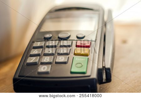 Payment With Credit Card - Businessman Holding Pos Terminal. Payment Card In A Bank Terminal. The Co