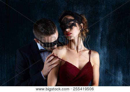 Rich Millionaire Man Male In Black Carnaval Mask Bow Tie And Suit Seduces Tempts Lures Woman Female