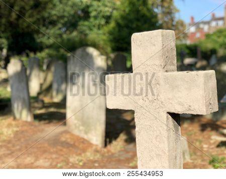 Graveyard cross headstone