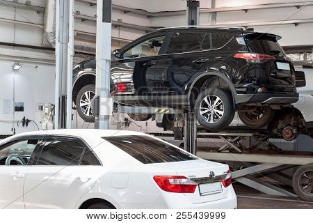 Russia, Izhevsk - April 21, 2018: Automobile Workshop. Car Repair In The Workshop On The Hydraulic L