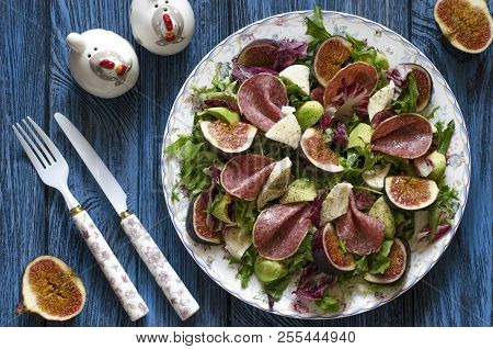Salad With Figs Salami Avocado Mozzarella And Arugula