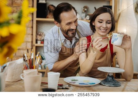 Couple Of Ceramists Laughing While Joking In The Process Of Work