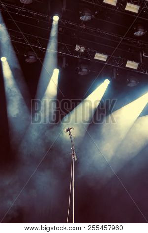 Microphone Standing On The Empty Dark Stage Before Concert