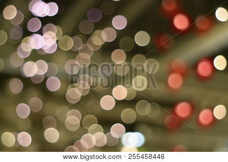 Abstract Blurred Interior Decorated Lighting In Light Brown Red And Pale Pink Color Gradations