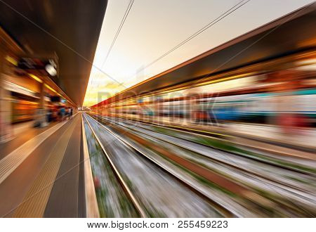 Platforms of  railway station at sundown in the motion blur - abstract background            poster