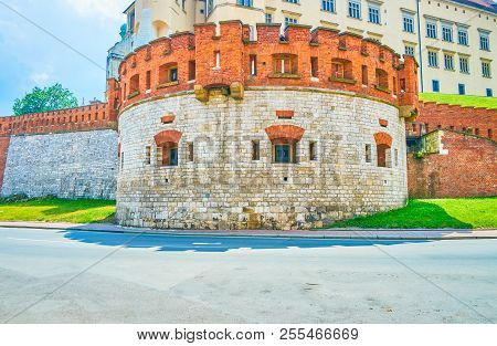 The Round Defensive Sigizmund Iii Vasa Tower Has Numerous Windows-embrasures And Battlements On The