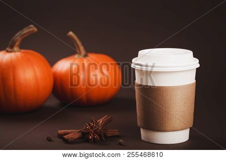 Paper Cup Of Coffee To Take Away With Spices And Pumpkin. Concept Of Autumn Spicy Latte. Place For T