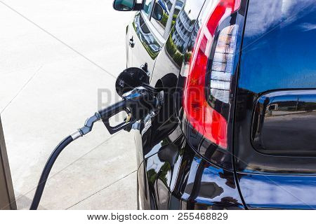 Car Refueling On Petrol Station. Fuel Pump With Gasoline. Fuel Industry Or Transportation Concept