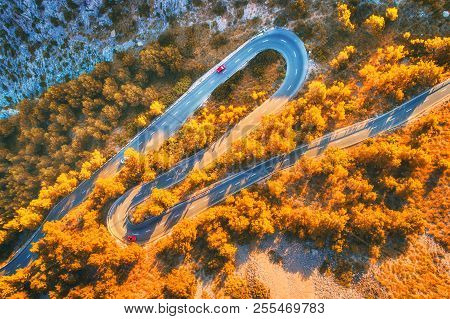 Aerial View Of Mountain Curve Road With Cars, Orange Forest At Sunset In Autumn In Europe. Landscape