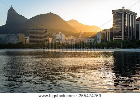 Corcovado Mountain By Sunset View, With Buildings Of Botafogo District, In Rio De Janeiro