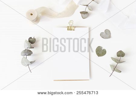 Feminine Wedding Desktop Stationery Mockup With Blank Greeting Card, Dry Eucalyptus Leaves, Silk Rib