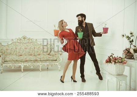 Floral Shop Concept. Couple In Floral Shop. Sensual Woman And Bearded Man In Floral Shop. Shopping F
