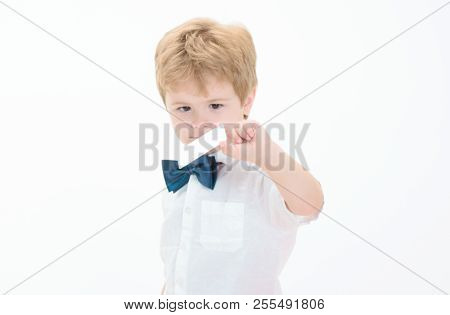 Happy Little Boy With Blank Credit Card. Smiling Small Boy Holds Business Card. Cash. Cashless Calcu