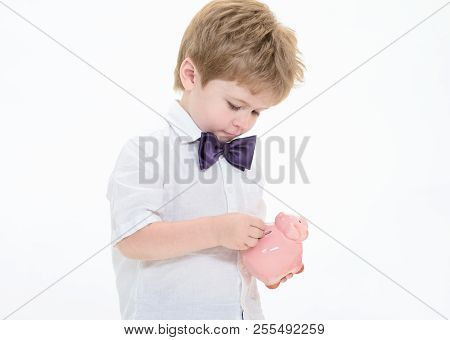 Banking, Investments, Money Saving Concept. Boy Putting Coins In Piggy Bank. Little Boy With Piggy B