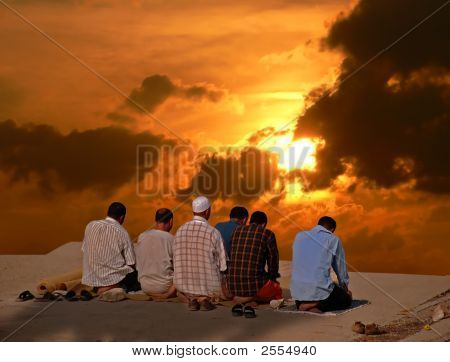 Muslims Praying At Sunset