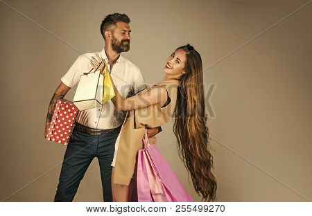 Shopping And Sale. Girl And Bearded Man Hold Present Pack, Cyber Monday. Black Friday, Happy Holiday