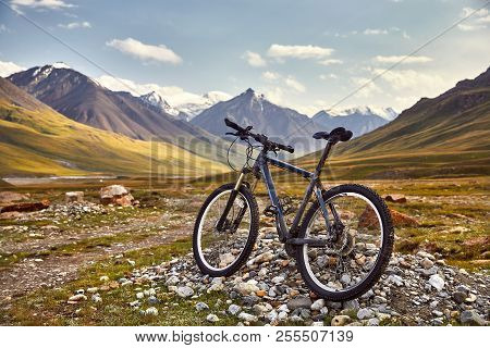 Dirty Bike For Cross Country Riding And Beautiful Landscape Of Mountain Valley. Extreme Riding And T