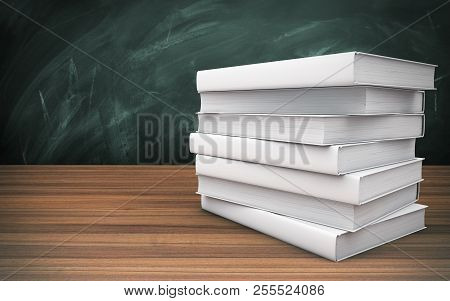 Pile Of Books On The Wooden Table. 3d Rendering