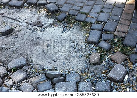 Broken Pavements Sidewalks On The Sidewalk. Pavement With Paving Slabs With Defects And Cracks Going