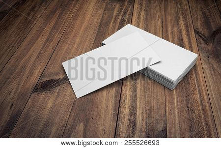 Business Cards On Wooden Table. 3d Rendering