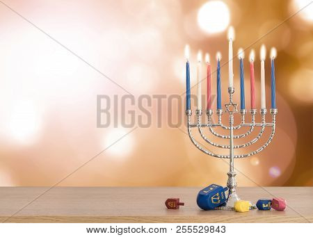 Hanukkah Jewish Holiday Background With Menorah (judaism Candelabra)  Burning Candles And Traditiona