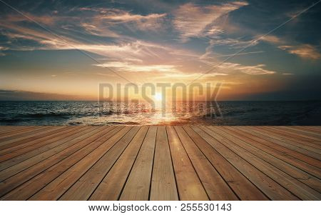 Empty Wooden Deck And Beautiful Sunset On The Sea