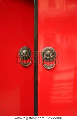 Chinese Door Way With Handles And Gargoyles