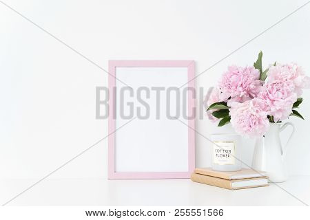Cute Pink Portrait A4 Frame Mock Up With A Pink Peonies In Jug Beside The Frame, Overlay Your Quote,