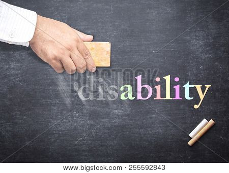 World Disable Day Concept: People Hand Holding Eraser For Change Word