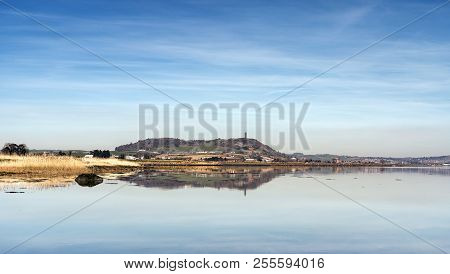 A View Across Strangford Lough Towards Scrabo Tower With Lovely Reflections.