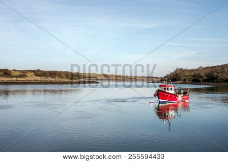 A Pretty Red Boat At Sketrick In Northern Ireland.