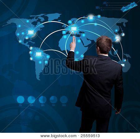 Businessman hand pressing digital button on futuristic map