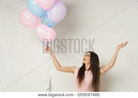 Careless And Freedom Concept. Happy Girl With Bunch Of Balloons, Copy Space