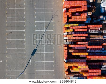 Ukraine, Kyiv. April 08, 2018. Aerial view from a drone of parking lot, marking parking spaces and construction warehouse for the sale of building materials for construction and repair. Top view.