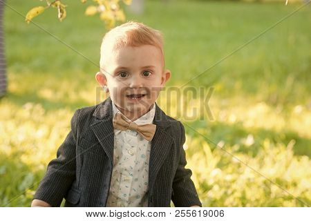 Child Smile With Bow Tie On Summer Day, Vacation. Little Boy With Bowtie On Natural Landscape, Fashi