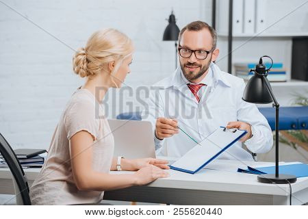 female patient having appointment with chiropractic in clinic poster